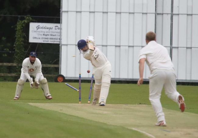 Matthew Batkin's stumps are sent flying in Whitchurch's defeat to Sentinel. Picture by Ian Stading
