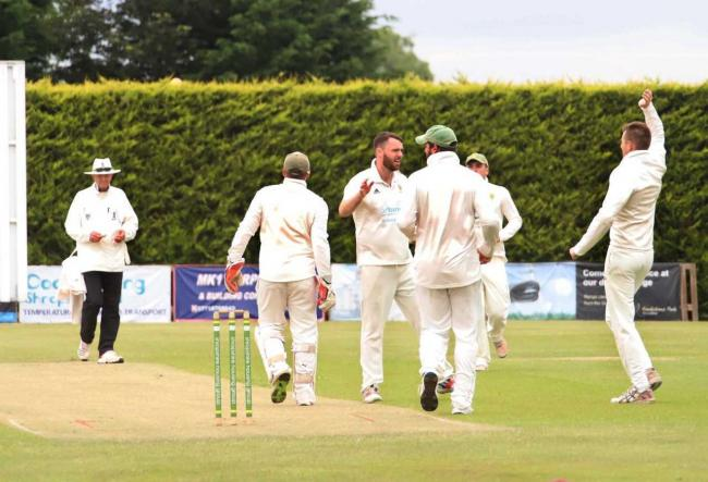Tom Astley celebrates another wicket for Wem. Picture by Ian Stading