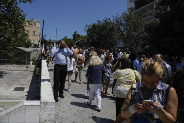 People in the streets after a strong earthquake hit Athens