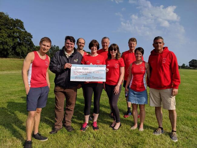 Whitchurch Whippets with the cheque