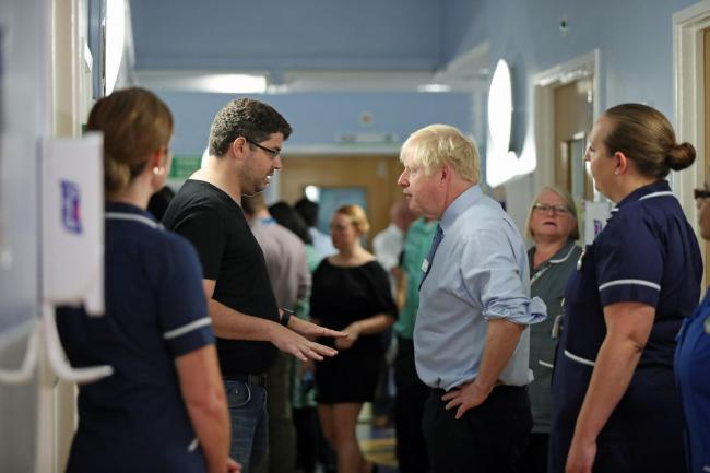 Boris Johnson talks with parent