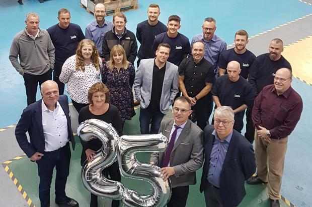 The staff at Landia celebrate 25 years in the UK
