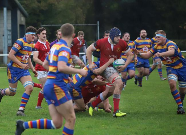 Whitchurch's Jake Reece powers through the tackles. Picture by Ian Stading