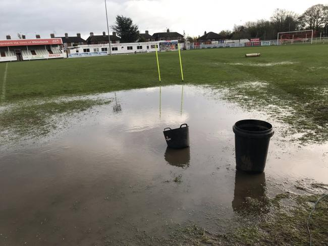 The waterlogged pitch on Monday morning
