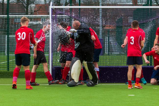 Whitchurch Hockey Club celebrate promotion. Picture by Louis Tinsley