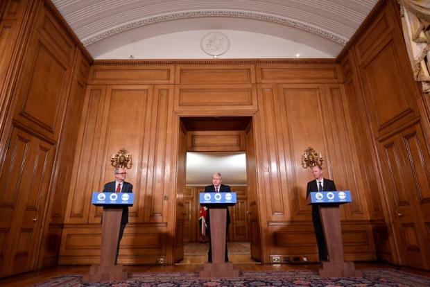 Whitchurch Herald: Prime Minister Boris Johnson addressed the nation with his chief advisors to announce new restrictions. (Toby Melville/PA)