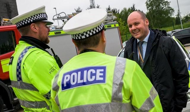 Cheshire PCC David Keane with officers.