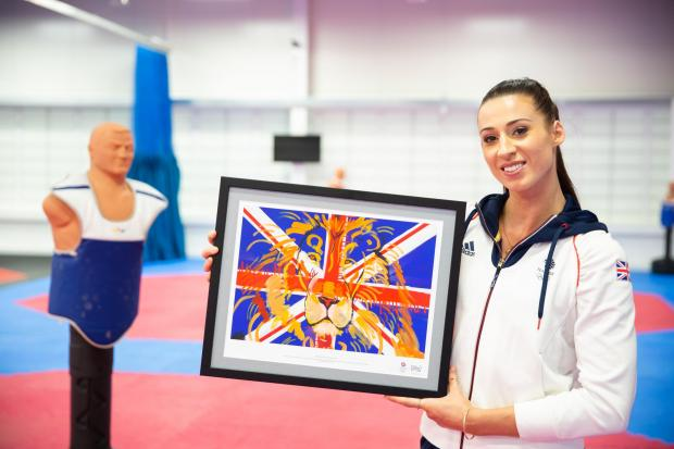Whitchurch Herald: Walkden, 29, enters the Games as the reigning heavyweight world champion and is bidding to build on the bronze she took home from Rio in 2016