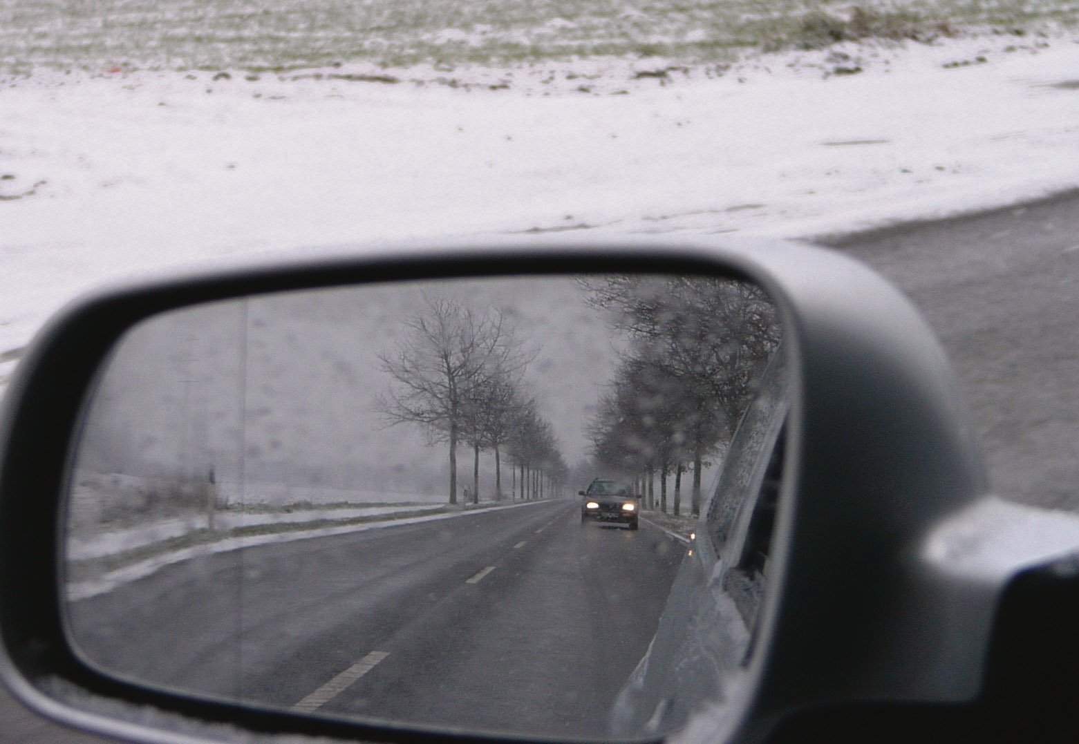 Winter driving.snow.car.wing mirror.ice.road.