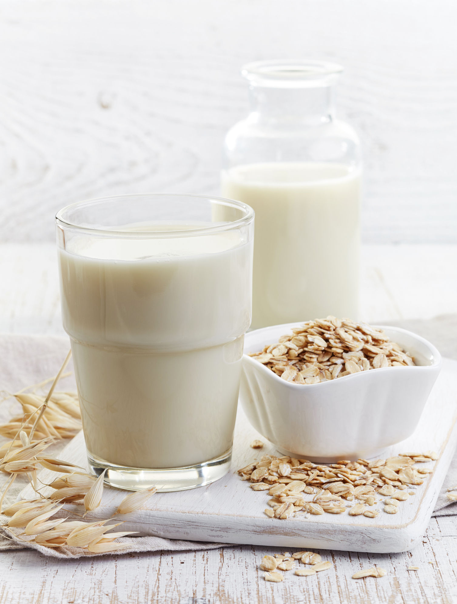 A generic photo of a glass of oat milk on white wooden background. See PA Feature TOPICAL Wellbeing Oat Milk. Picture credit should read: PA Photo/thinkstockphotos. WARNING: This picture must only be used to accompany PA Feature TOPICAL Wellbeing Oat Milk