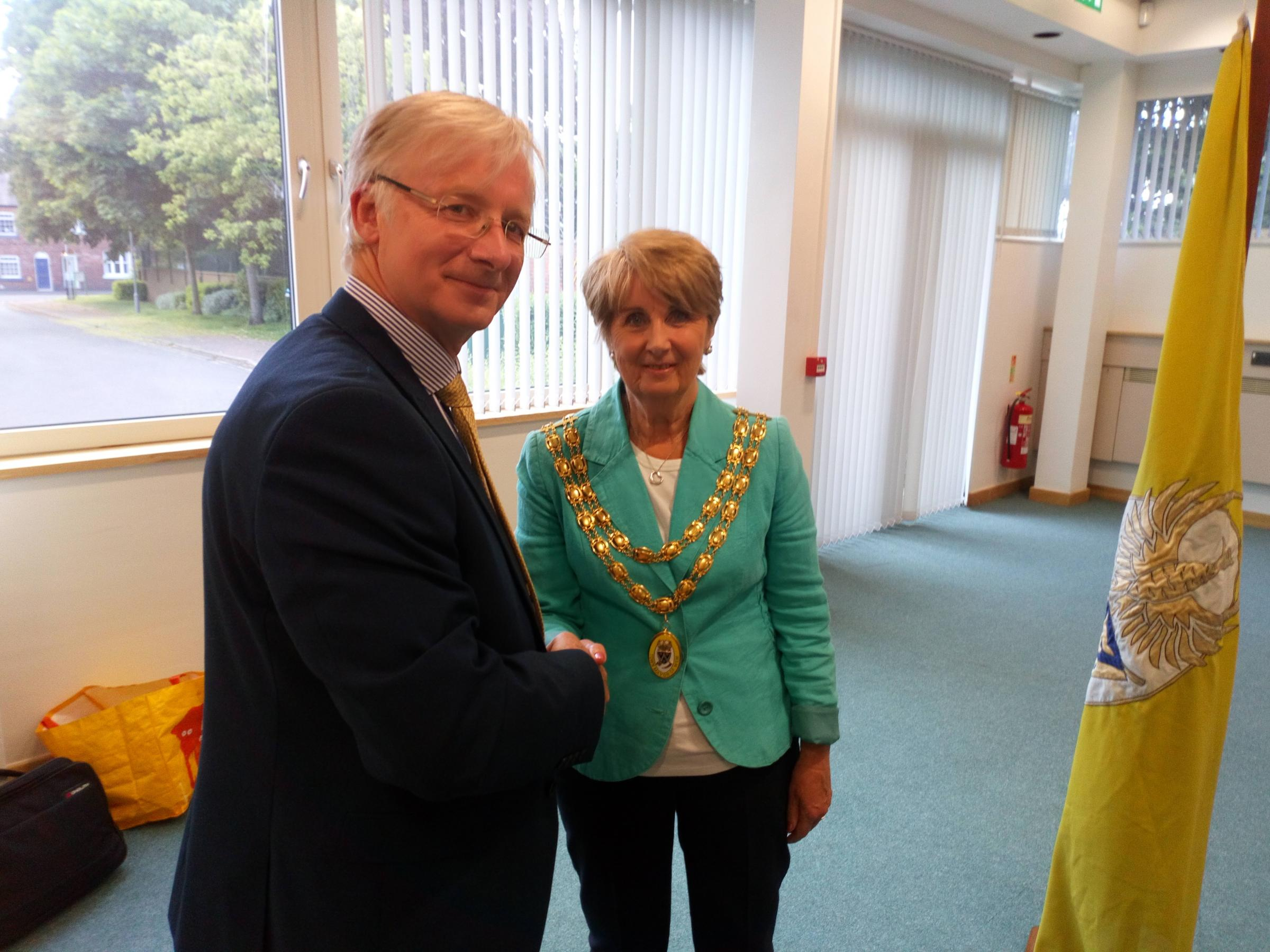 Outgoing mayor of Wem, Cllr Edward Towers, congratluates new incumbent Cllr Connie Granger on her election.