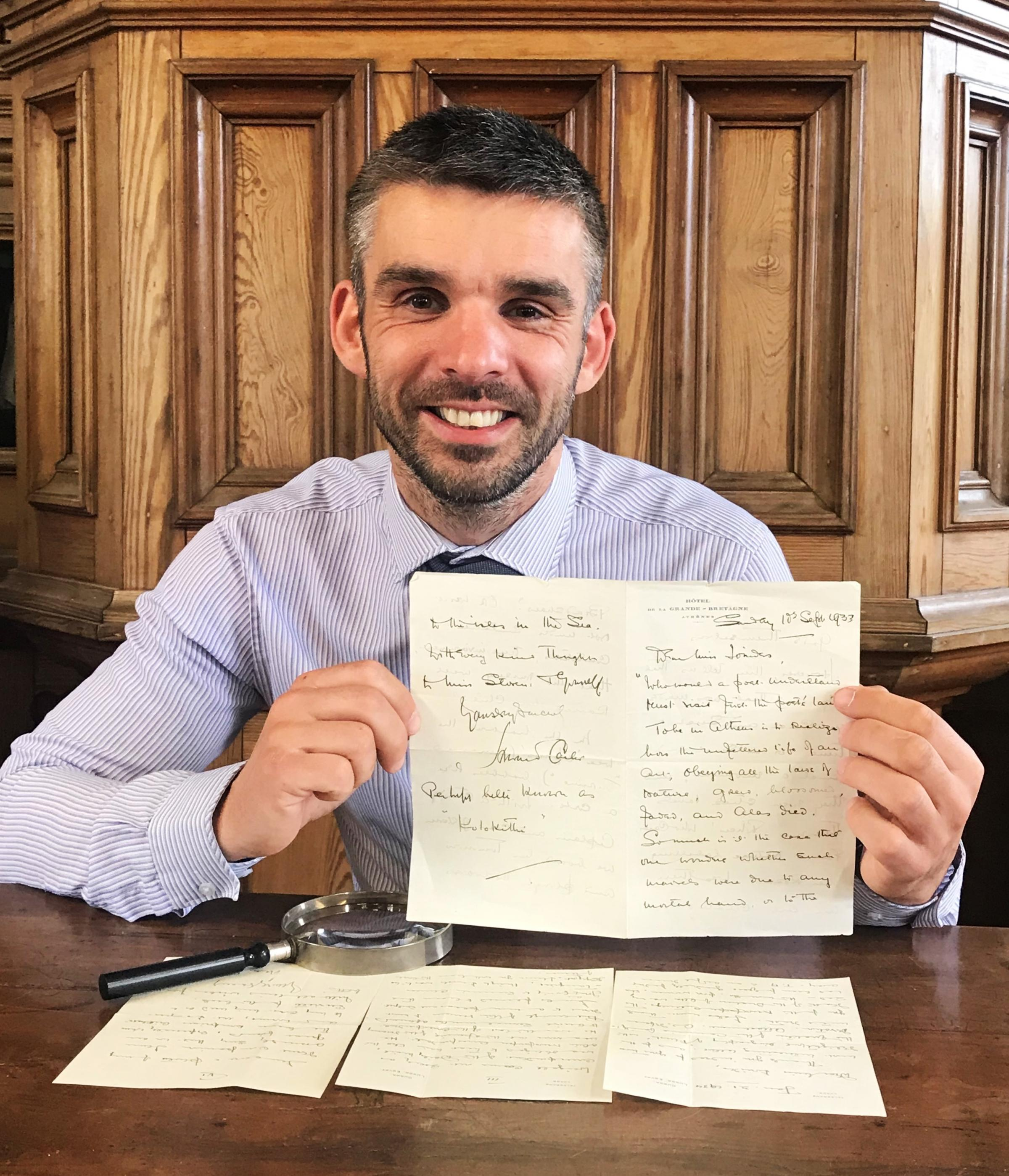 Aaron Dean with the Howard Carter letters which                  were sold at auction