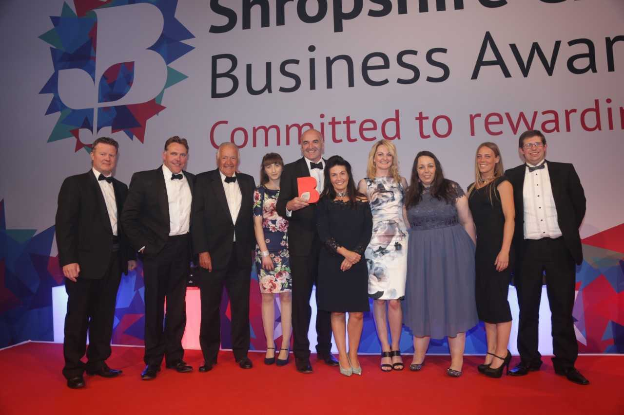 Staff at Whitchurch's Stallion AI celebrate another Shropshire business award