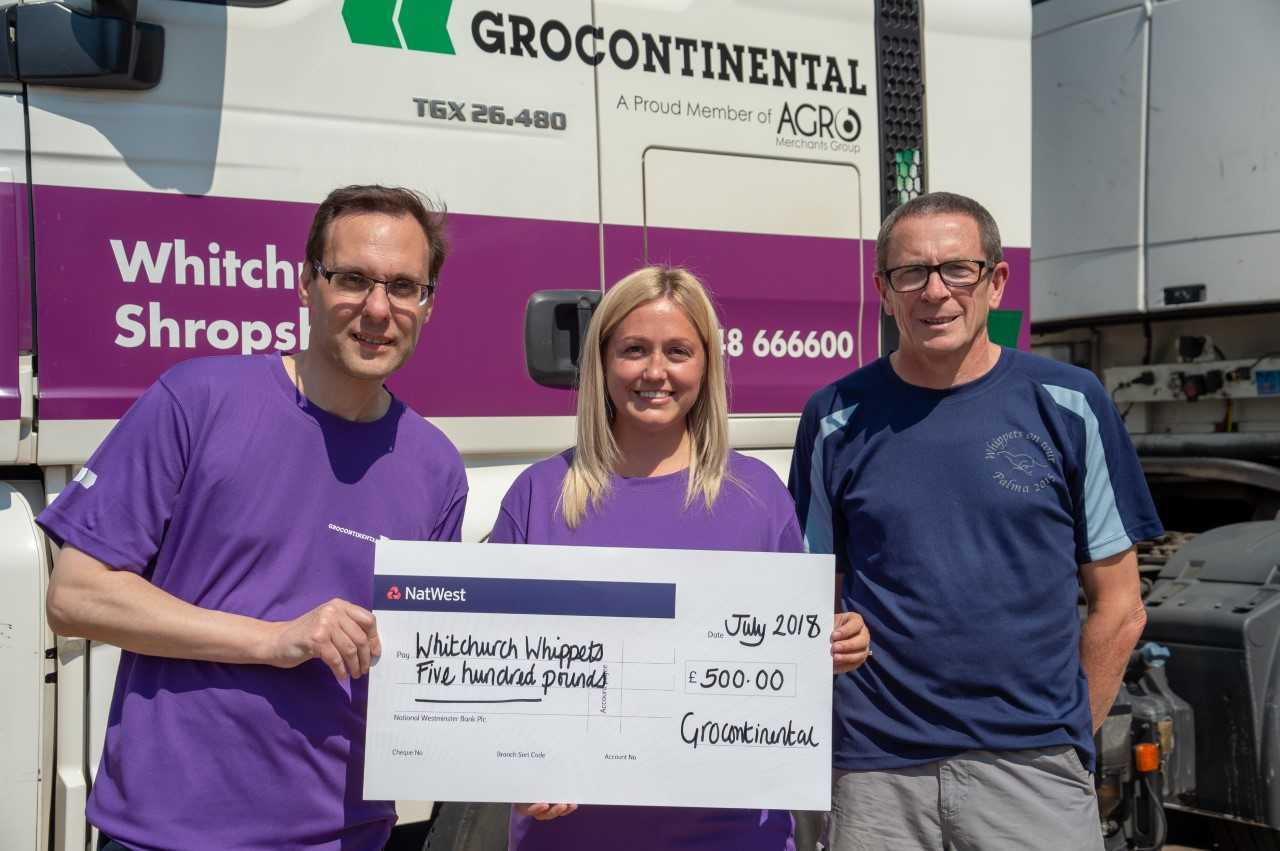 Robert Ellis and Dionne Loftus from Grocontinental hand over the company's sponsorship cheque to John Dillon, chairman of Whitchurch Whippets