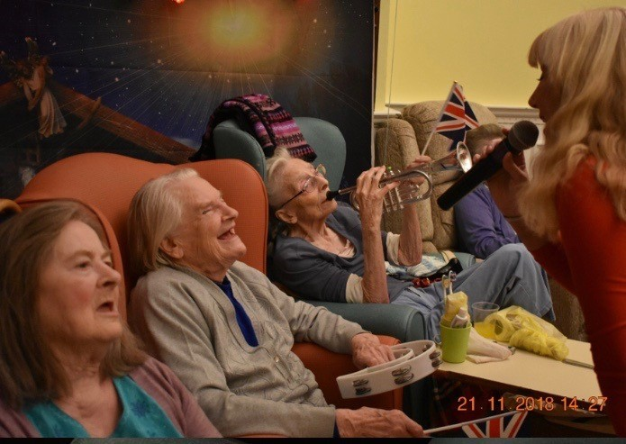 Ellesmere House care home residents enjoying the entertainment