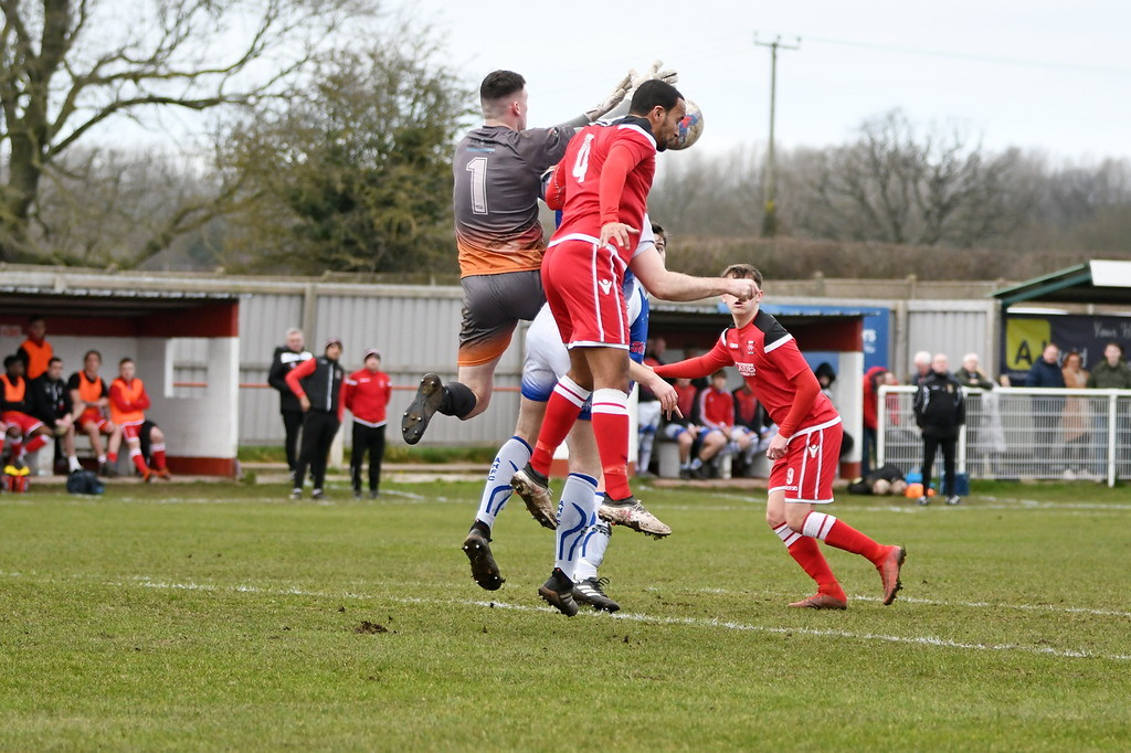Leon Ashman challenges for the ball against Abbey Hey. Picture by Josh Pearce