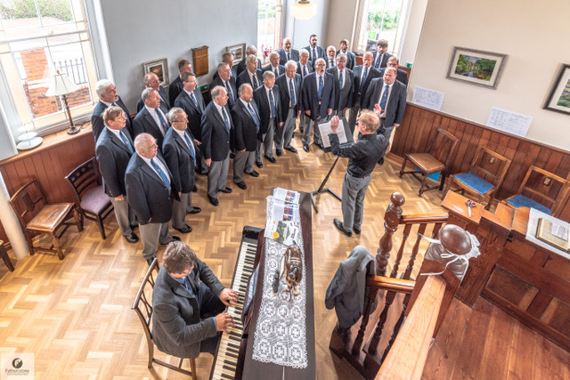 Froncysyllte Male Voice Choir entertain guests at the official opening. Picture: Mark Fetherstone
