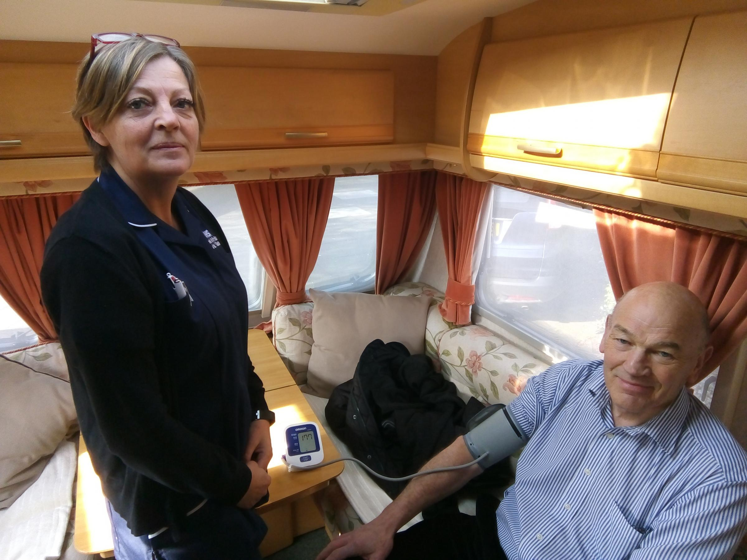 Michelle Whitaker, of Whitchurch Community Hospital, gives a blood pressure test to Mike Allman, 73, of Coton