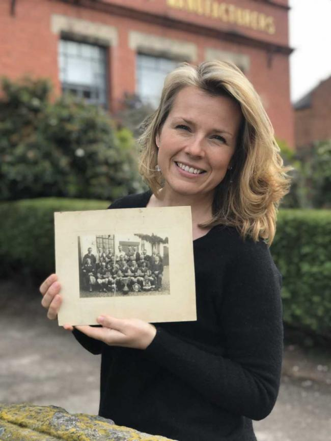 Christina Trevanion with the picture of the football medals