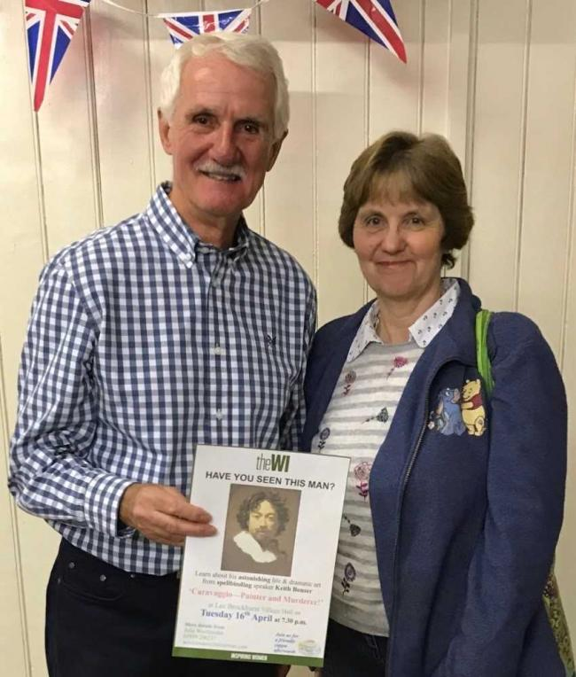 Keith Bonser, and member, Ann Hall, with a 'Wanted' poster