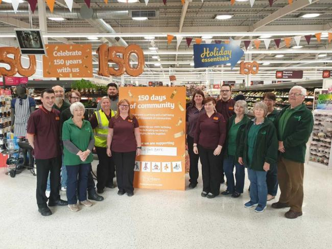 Sainsbury's staff members and foodbank staff come together